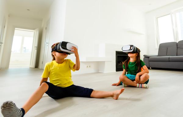 Niños jugando a videojuegos 3D
